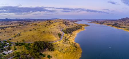 Australian countryside and lake at dusk - aerial panorama