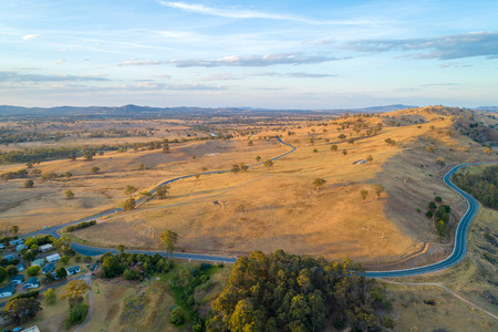 Riverina Highway passing through scenic countryside at sunset. New South Wales, Australia 写真素材