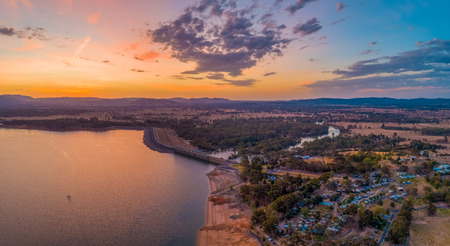 Lone boat sailing across Lake Hume near the Dam at twilight - aerial pano
