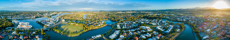 Wide aerial panorama of beautiful sunset over luxury suburb on the Gold Coast, Queensland, Australia