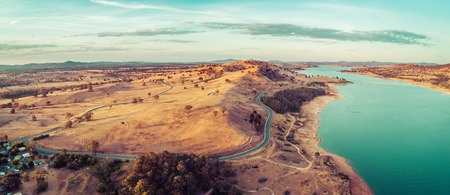 Aerial panorama of Riverina Highway passing near Lake Hume and Murray River at sunset. New South Wales, Australia 写真素材