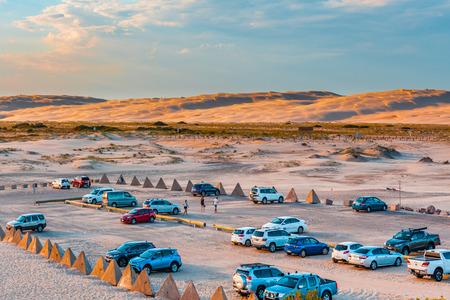 Car park on the sand near Birubi beach at sunset. Anna Bay, New South Wales, Australia