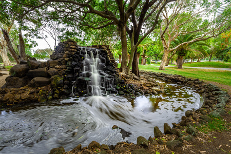 Blurred motion of water flow of a small waterfall in Surfers Paradise, Queensland, Australia Stock fotó