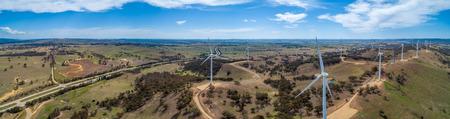 Wide aerial panorama of Hume Highway and wind farm in beautiful Australian countryside. Breadalbane, NSW, Australia 写真素材