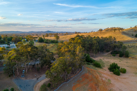 Countryside landscape at sunset - trees and hills. Lake Hume Village, New South Wales, Australia