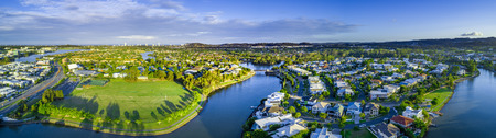 Wide aerial panorama of Reedy creek and luxury houses. Varsity Lakes, Gold Coast, Queensland, Australia