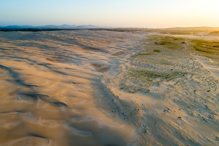 Aerial view of sand dunes near the ocean at sunset. Anna Bay, New South Wales, Australia Banco de Imagens