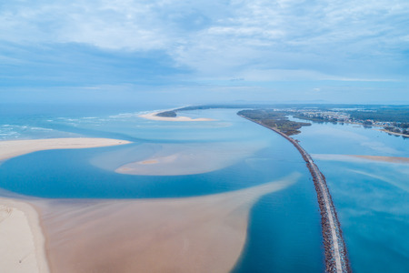 Aerial view of Harrington Breakwall and Manning River mouth. Harrington, New South Wales, Australia