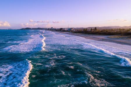 Aerial landscape of Palm Beach suburb coastline at sunset. Gold Coast, Queensland, Australia
