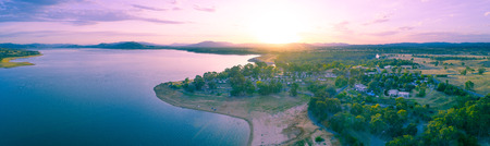 Beautiful lake and countryside at sunset - aerial panorama