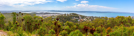 Wide panorama of the lush green vegetation and coastline. Gan Gan lookout, Nelson Bay, New South Wales, Australia