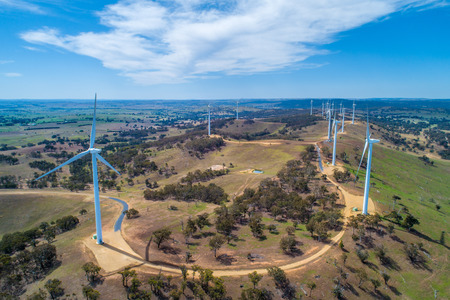 Aerial landscape of wind turbines farm on bright sunny day in New South Wales, Australia
