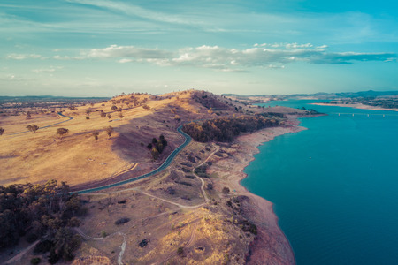 Aerial view of Lake Hume and Riverina Highway at sunset.