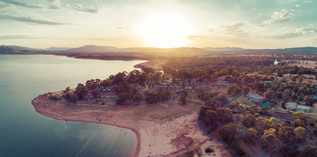 Aerial panorama of Lake Hume coastline at sunset. Lake Hume Village, New South Wales, Australia