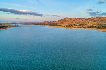 Bridge across Murray River and Lake Hume at sunset - aerial landscape Banco de Imagens