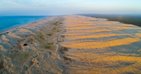 Aerial panorama of Stockton beach sand dunes at sunrise. Anna Bay, New South Wales, Australia
