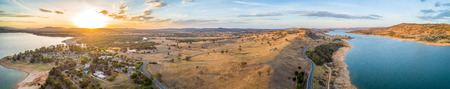 Wide aerial panorama of Lake Hume Village and Murray River at sunset