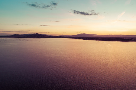 Scenic mountain lake at sunset - aerial view with copy space
