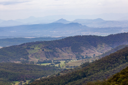 Beautiful countryside with forested hills and grassy plains in Queensland, Australia