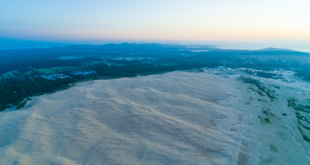 Aerial panorama of ocean coastline and famous landmark sand dunes. Anna Bay, New South Wales, Australia