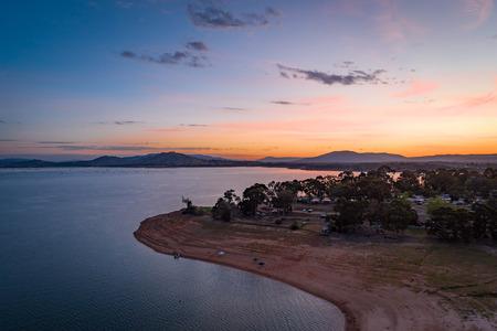 Lake coastline at twilight - aerial view