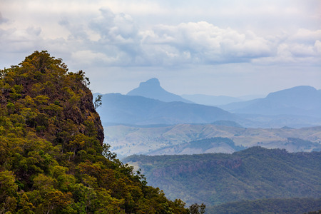 Forested cliff on hazy day in Queensland, Australia