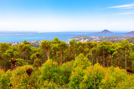 Vivid green eucalyptuses and islands in the ocean. Gan Gan lookout, Nelson Bay, New South Wales, Australia Stock Photo