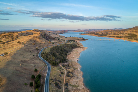 Riverina Highway and bridge across Murray River at sunset. Lake Hume Village, New South Wales, Australia