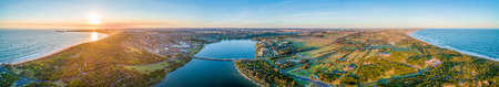 Wide aerial panorama of Warrnambool and Hopkins River at sunset. Victoria, Australia 免版税图像