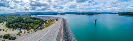 Scenic aerial panorama of Cardinia Reservoir lake and park on overcast day in Melbourne, Australia