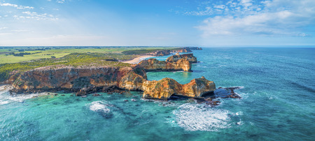 Scenic aerial panorama of eroding rocks on ocean coastline near Warrnambool, Australia Stock Photo