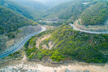 Great Ocean Road bends through hills near the coastline