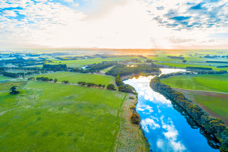 Bright sunset over river in countryside