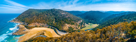 Wide aerial panorama of Great Ocean Road and hills near Lorne on bright sunny day