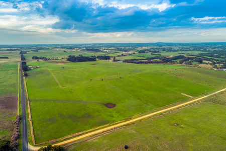 Aerial view of roads passing through scenic grasslands in rural Australia