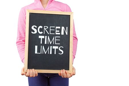 Screen time limits for children issue depicted with child holding blackboard with text and copy space