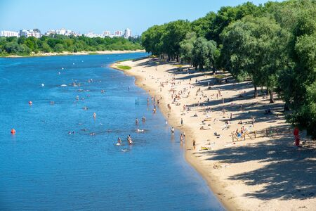 People swimming in the Sozh river in summer. Gomel, Belarus