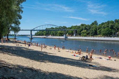 Gomel, Belarus - June 19, 2019: People relaxing on the beach of river Sozh in summer Archivio Fotografico - 137909002