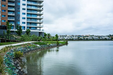 Lake and luxury housing at Varsity Lakes suburb in Queensland, Australia 写真素材