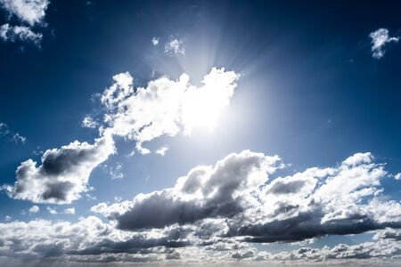 Sun shining through clouds background overlay Stockfoto - 128283511