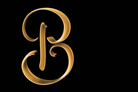 Golden capital letter B isolated on black with copy space - hand lettering