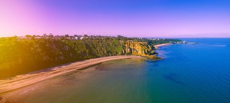 Aerial view sunrise over Edward Street Beach and Red Bluff in Black Rock, Melbourne, Australia Фото со стока