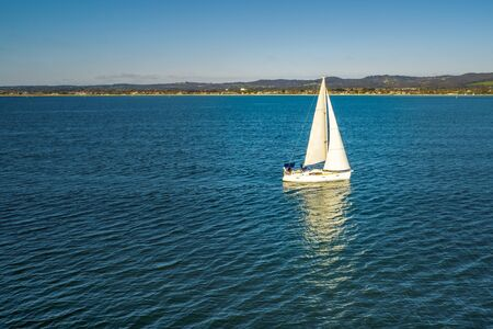 Beautiful white sailboat in Port Phillip Bay, Australia Stok Fotoğraf - 129925726