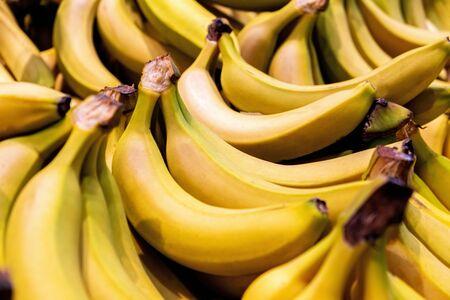 Pile of bright yellow bananas closeup with shallow focus Stok Fotoğraf
