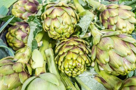 Pile of artichokes with shallow depth of field