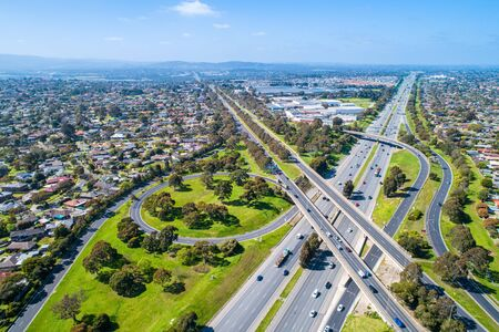Aerial view of highway interchange in Melbourne, Australia on sunny day