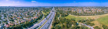 Wide aerial panorama of Monash Freeway passing through Wheelers hill suburb in Melbourne, Australia Stockfoto