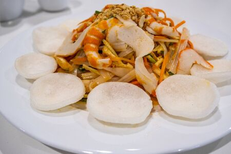 Vegetarian seafood with papaya salad - Vietnamese dish on white plate