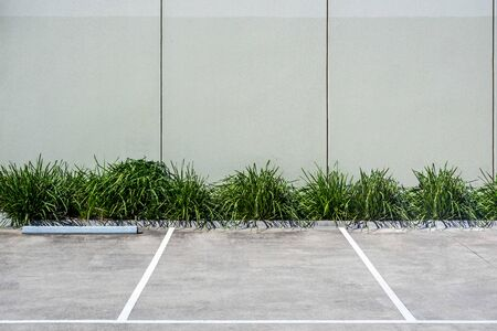 Unoccupied parking space in industrial area with copy space