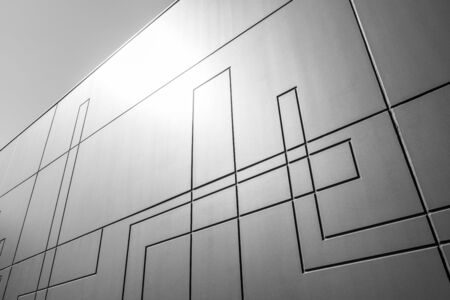 Architectural minimalism concept - perspective view of concrete wall with geometric line pattern